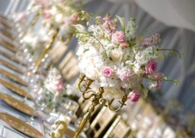 Romantic pink and gold centerpieces by our wedding planners.