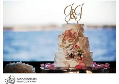 Accent your wedding cake with coordinating flowers. We can work with your cake vendor about needed flowers.