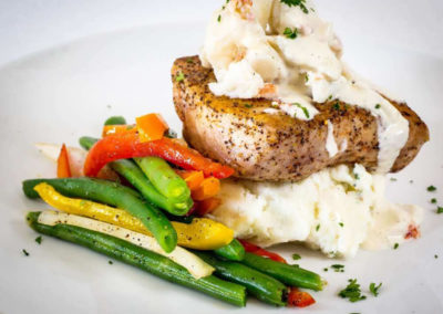 Our SOLARIS chefs use only fresh local seafood like Gulf Fish w lump crabmeat.