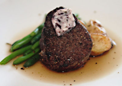 Indulge in prime steaks served with fresh vegetables while cruising the local waters.