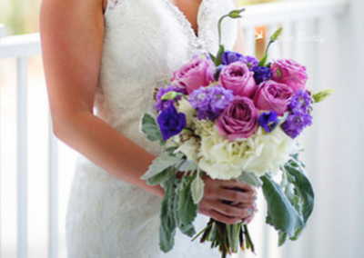 Our team can help bring meaning to your wedding flowers with certain colors, personalized items and more.