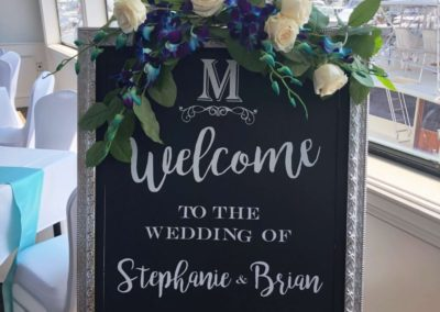 Custom signs and flowers by our wedding planners