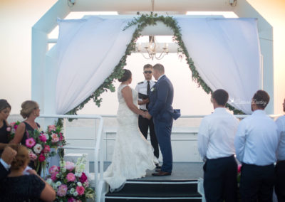 Our wedding planners can customize the altar on the sky deck with flowers, fabric and even a chandelier!