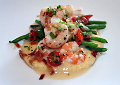 Indulge in coastal cuisines such as Shrimp and Grits, Fresh Gulf Seafood, Crab Cakes and more.