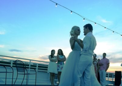 First dance as man and wife on the sky deck at sunset.