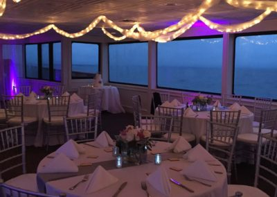 Our wedding planners can custom design your reception out at sea with specialty lights, flowers, accent walls and more.