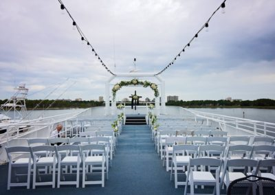 The open-air sky deck features a bridal platform, bridal arch and photo platform with the sunset and open waters as your romantic backdrop.