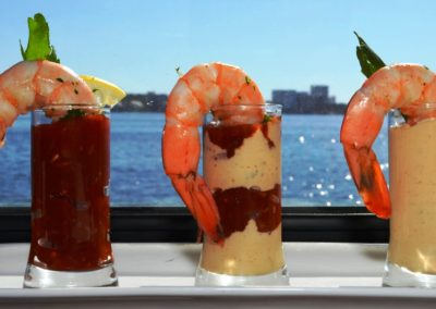 Creative wedding menu ideas include fresh Gulf shrimp shooters, served with a view.