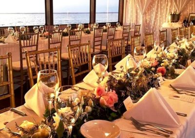 Romantic floral table runners for this reception out at sea.