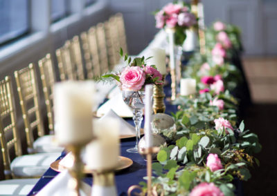 Stunning floral runners and centerpieces by our wedding planners