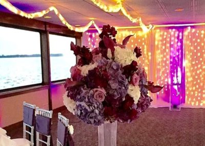 Centerpieces and custom accent lighting for this reception out at sea