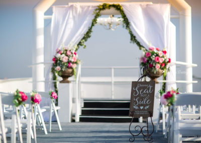 Custom flowers, sign, fabric and chandelier on the sky deck by our wedding planners